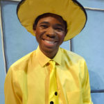 Anna Jordon as Curious George and J. Isaiah Smith as The Man in the Yellow Hat in The Rose Theater's production of CURIOUS GEORGE & THE GOLDEN MEATBALL.
